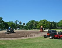 Fred & Ryan move soil on #16 green to reshape the front area.  This will allow for more pin placements.